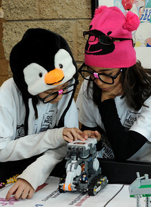 (l-r) Emerie Weiss, 10, and Melina Estrada,12, are from Girl Scout Troup 240 in Burbank. The pair worked on their robot getting it ready to run the course. Chaminade College Preparatory Middle School?hosted the LEGO league Food Factor Challenge. The idea was to use robotics and LEGO's to inspire creative thinking in food safety research. Kids dressed  up in costumes, and programmed computer vehicles to automatically drive a field and move objects. Chatsworth, CA 12/16/2011(John McCoy/Staff Photographer)