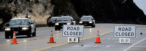 CHP patrol PCH highway as multiple rockslide near County Line Beach has forced closure of state Route 1 at the western end of Malibu, California Highway Patrol officers said today.  Caltrans officials ordered PCH closed between Yerba Buena and Las Posas roads at 8:10 p.m. Sunday, when the rockslide was first reported.  Caltrans geologists were being brought in to check cliffs above the highway near Point Mugu to ensure they are stable, before any decision would be made about reopening it. Malibu CA.  Dec 20,2010.  photo by Gene Blevins/LA Daily News