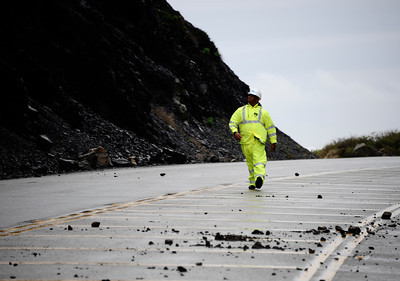 Cal-Trans official Patrick Chandler keeps his eye on falling rocks that continue to fall from multiple rockslide near County Line Beach has forced closure of state Route 1 at the western end of Malibu, California Highway Patrol officers said today.  Caltrans officials ordered PCH closed between Yerba Buena and Las Posas roads at 8:10 p.m. Sunday, when the rockslide was first reported.  Caltrans geologists were being brought in to check cliffs above the highway near Point Mugu to ensure they are stable, before any decision would be made about reopening it. Malibu CA.  Dec 20,2010.  photo by Gene Blevins/LA Daily News