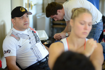 Grappling coach Gokor Chivichyan watches as  two-time olympian and world champion judo practitioner  Ronda Rousey prepares to make her professional mixed martial arts debut on March 27, 2011 at King of the Cage: Turning Point. She submitted Ediane Gomes with an armbar in 25 seconds (Hans Gutknecht/Staff Photographer)