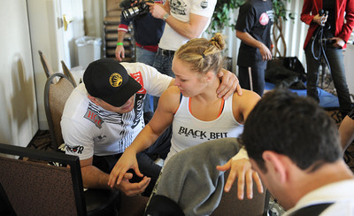 Ronda Rousey waits backstage with grappling coach Gokor Chivichyan  as striking coach Edmond Tarverdyan prepares to wrap her hands before making her professional mixed martial arts debut on March 27, 2011 at King of the Cage: Turning Point. She submitted Ediane Gomes with an armbar in 25 seconds (Hans Gutknecht/Staff Photographer)