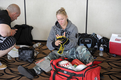 A two-time olympian and world champion judo practitioner  Ronda Rousey tries on her gloves before making her professional mixed martial arts debut on March 27, 2011 at King of the Cage: Turning Point. She submitted Ediane Gomes with an armbar in 25 seconds (Hans Gutknecht/Staff Photographer)