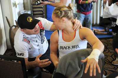 Ronda Rousey waits backstage with grappling coach Gokor Chivichyan before making her professional mixed martial arts debut on March 27, 2011 at King of the Cage: Turning Point. She submitted Ediane Gomes with an armbar in 25 seconds (Hans Gutknecht/Staff Photographer)