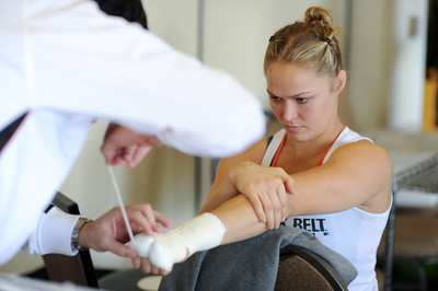 Striking coach Edmond Tarverdyan wraps Ronda Rousey's hands  before making her professional mixed martial arts debut on March 27, 2011 at King of the Cage: Turning Point. She submitted Ediane Gomes with an armbar in 25 seconds (Hans Gutknecht/Staff Photographer)