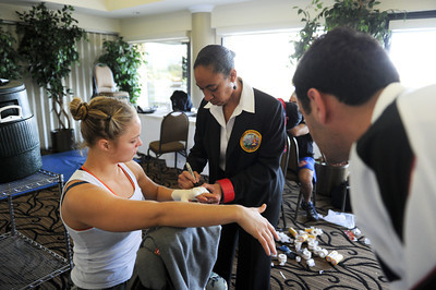 Judge Valerie Douglas checks Ronda Rousey's wraps before her fight against Ediane Gomes at the Braemar Country Club Sunday March 27, 2011 at the  in Tarzana, CA. (Hans Gutknecht/Staff Photographer)