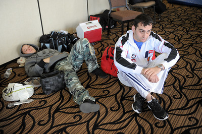 Striking coach Edmond Tarverdyan sits next to two-time olympian and world champion judo practitioner  Ronda Rousey rests before making her professional mixed martial arts debut on March 27, 2011 at King of the Cage: Turning Point. She submitted Ediane Gomes with an armbar in 25 seconds (Hans Gutknecht/Staff Photographer)