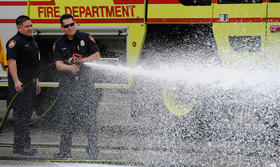 Bob Hope Airport Fire Department firefighters Guillermo Perez, left,  and Jimmy Luera demonstrate there new addition to the department's fleet a Rosenbauer ARFF Panther Class 4 Aircraft Rescue and Firefighting vehicle at the the Burbank Airport Monday, February 6, 2012.  The Firefighting vehicle is the first in the country to be equipped with a Compressed Air Foam firefighting system and can carry up 1,500 gallons of firefighting agent. (Hans Gutknecht/Staff Photographer)