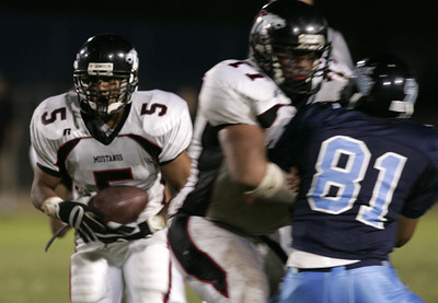 Arleta Nick Ferlini looks to gain yardage  away from Sylmar Lee Harris during the game on Friday, September 7, 2007 (Edna T. Simpson)