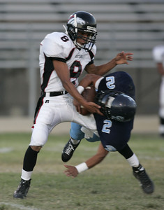 Sylmar's Josh Pons gets tackled by Arleta Brayan Torres during the first half of the game on Friday, September 7, 2007. (Edna T. Simpson)