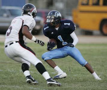 Sylmar Charles Roberson tries to go around Arleta Nicik Ferlini during the first half of the game on Friday, September 7, 2007 (Edna T. Simpson)