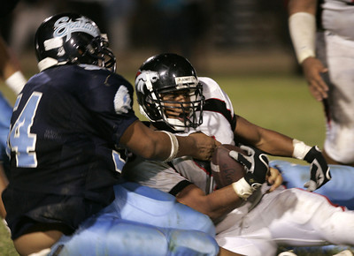 Arleta'S Bryan Choto gets tackled by Sylmar Deandre Roberts during the game Friday, September 7, 2007 . (Edna T. Simpson)