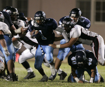 Sylmar's Charles Roberson gains yardage before getting tackle during the game on Friday, September 7, 2007 against Arleta. (Edna T. Simpson)