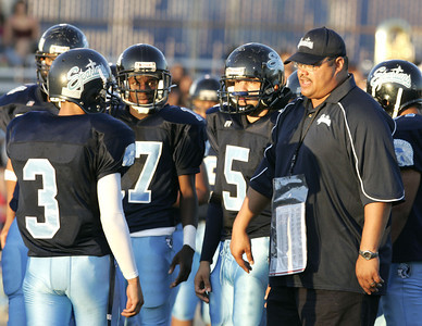 Sylmar's Head Coach London Woodfin talk with his players before the game against  Arleta's High School on Friday, September 7, 2007 (Edna T. Simpson)