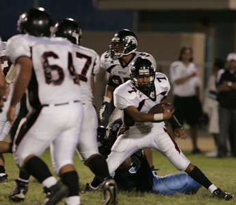 Arleta's Bryan Choto breaks away from Sylmar Deandre Roberts during the game on Friday, September 7. 2007 (Edna T.Simpson)
