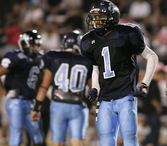 Sylmar's Charles Roberson looks to the sidelines for instructions from the coach during the victory game on Friday, September 7, 2007 against Arleta High School. (Edna T. Simpson)