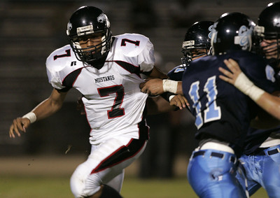 Arleta's Bryan Choto gets held back by Sylmar's defense during the game on Friday,September 7, 2007 against  Sylmar. (Edna T. Simpson)