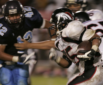 Arleta's Omar Barrera-Sanchez tries to get past Sylmar's Angel Anguiano during the game on Friday, September 7, 2007 (Edna T. Simpson)