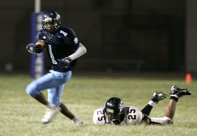 Sylmar's Charles Roberson breaks away from  Arleta Omar Barrera-Sanchez during the victory game on Friday, September7, 2007. (Edna T. Simpson)