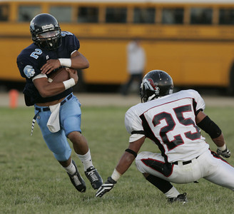 Sylmar Josh Pons protects the ball while going up against  Arleta  Omar Barrera-Sanchez during the first half of the victory game on Friday, September 7, 2007. (Edna T. Simpson)