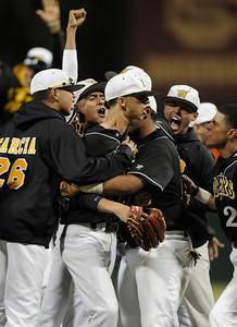 San Fernando mobs pitcher David Lira after the final out in the 10th inning of a 2-1 San Fernando victory over El Camino Real in the Semi Finals at Dedeaux Field on the campus of USC. Los Angeles CA 6-1-2011. (John McCoy/Staff Photographer)