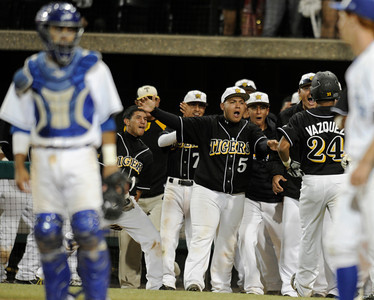 San Fernando #24 William Vazquez is welcomed to his bench after being driven in by Jose Rias in the 10th inning.  San Fernando played El Camino Real in the Semi Finals at Dedeaux Field on the campus of USC. Los Angeles CA 6-1-2011. (John McCoy/Staff Photographer)