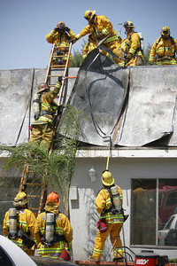 HOSPITAL FIRE--Firefighters work to put out a fire on the roof at the Santa Clarita Convalescent Hospital.  Firefighters found a roof fire when they arrived on the scene and evacuations were under way.  About 100 patients were evacuated in the fire.  TO GO WITH ADOB STORY.    Photo by David Crane/Staff Photographer.