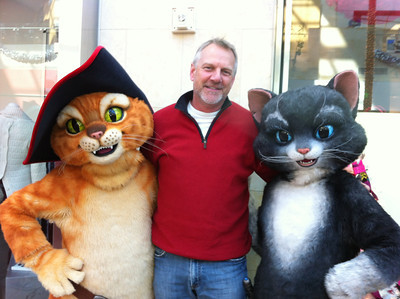 Mickie Sullivan caught the Daily News' Rodney Scholtes with a couple of felines at Santa Walk 2011 at Westfield Topanga.