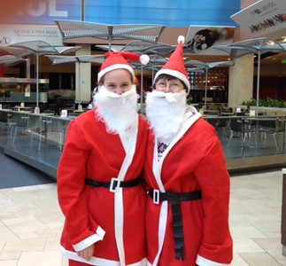 Ann Volmer submitted this photo of herself and another Santa-clad participant in Santa Walk 2011 at Westfield Shoppingtown Topanga.