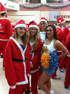 Mickie Sullivan sent this Santa Walk 2011 picture of young Santas and a UCLA cheerleader.