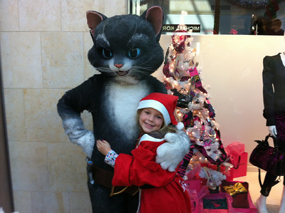 Mickie Sullivan sent in this picture of a young Santa and a very tall cat at Westfield Topanga's Santa Walk 2011.