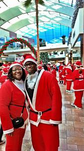 Catherine Outing and son Brandon Samuel have the Santa spirit at Westfield Topanga's Santa Walk 2011.