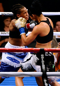 (in blk trunks) Female boxer Kaliesha West goes 7 rounds with Angel Gladney,  as Kaliesha West TKO Angel Gladney in the middle of the 7th round to take the vacant WBO bantaweight title Saturday night at Staples Center in Los Angeles CA.  Sept 18,2010. Photo by Gene Blevins/LA Daily News