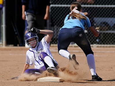 Valencia #3 Justine Sibthorp steals 2nd base when Saugus #11 Jenna Kelly can not get the throw in time. The Saugus girls defeated Valencia 4-2 in eight innings. Valencia, CA 5-10-2011. (John McCoy/staff photographer)