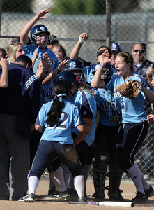 Erika Escedy is congratulated after belting a 2 run homer in the 8th inning. The Saugus girls defeated Valencia 4-2 in eight innings. Valencia, CA 5-10-2011. (John McCoy/staff photographer)