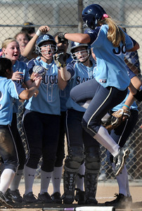 Erika Escedy leaps high into the air before landing on home plate after belting a 2 run homer in the 8th inning. The Saugus girls defeated Valencia 4-2 in eight innings. Valencia, CA 5-10-2011. (John McCoy/staff photographer)