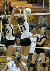 Saugus #10 Jaclyn Clark Saugus #21 Taylor Edwards block a spike by Valencia #4 Delaney Knudsen. The Valencia Girls volleyball team hosted Saugus in a Foothill League game. Saugus won in 3 straight games. Valencia, CA 9/27/2011(John McCoy/Staff Photographer)
