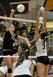 Valencia #23 Hayley Knapp spikes a ball to Saugus #3 Ashley Pagan. The Valencia Girls volleyball team hosted Saugus in a Foothill League game. Saugus won in 3 straight games. Valencia, CA 9/27/2011(John McCoy/Staff Photographer)