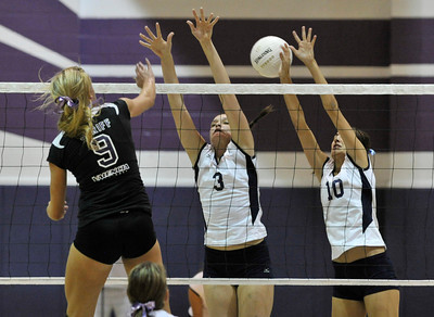Valencia #9 Sydney Striff has the ball blocked by Saugus #3 Ashley Pagan and Saugus #10 Jaclyn Clark. The Valencia Girls volleyball team hosted Saugus in a Foothill League game. Saugus won in 3 straight games. Valencia, CA 9/27/2011(John McCoy/Staff Photographer)