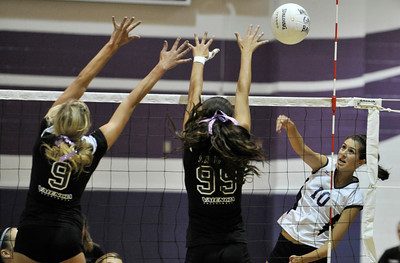 Valencia #9 Sydney Striff and Valencia #99 Sierra Sanchez go up to block a shot by Saugus #10 Jaclyn Clark. The Valencia Girls volleyball team hosted Saugus in a Foothill League game. Saugus won in 3 straight games. Valencia, CA 9/27/2011(John McCoy/Staff Photographer)