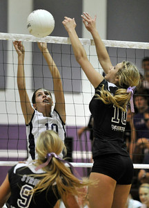 Saugus #10 Jaclyn Clark and Valencia #10 Carly Carapella battle at the net. The Valencia Girls volleyball team hosted Saugus in a Foothill League game. Saugus won in 3 straight games. Valencia, CA 9/27/2011(John McCoy/Staff Photographer)