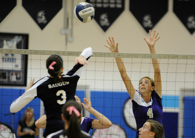 Saugus #3 Ashley Pagan gets ready to spike the ball against Valencia #4 Delaney Knudsen. Saugus girls' volleyball team defeated rival Valencia in 3 out of 4 games for first place in the Foothill League. Saugus, CA. 10/18/2011(John McCoy/Staff Photographer)