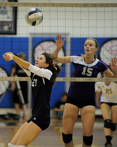 Saugus #21 Taylor Edwards bumps the ball while Valencia #15 Kellie Kleszcz waits. Saugus girls' volleyball team defeated rival Valencia in 3 out of 4 games for first place in the Foothill League. Saugus, CA. 10/18/2011(John McCoy/Staff Photographer)