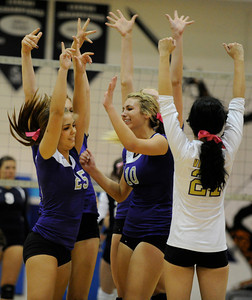 The Valencia girls had reason to cheer in the 3rd game,during their only win. Saugus girls' volleyball team defeated rival Valencia in 3 out of 4 games for first place in the Foothill League. Saugus, CA. 10/18/2011(John McCoy/Staff Photographer)