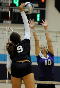 Saugus #9 Hannah Nua spikes the ball past Valencia #10 Carly Carapella. Saugus girls' volleyball team defeated rival Valencia in 3 out of 4 games for first place in the Foothill League. Saugus, CA. 10/18/2011(John McCoy/Staff Photographer)