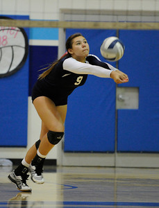 Saugus #9 Hannah Nua bumps the ball back into play. Saugus girls' volleyball team defeated rival Valencia in 3 out of 4 games for first place in the Foothill League. Saugus, CA. 10/18/2011(John McCoy/Staff Photographer)