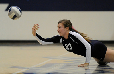 Saugus #23 Ashley Guthrie tries in vain to dive for a ball. Saugus girls' volleyball team defeated rival Valencia in 3 out of 4 games for first place in the Foothill League. Saugus, CA. 10/18/2011(John McCoy/Staff Photographer)