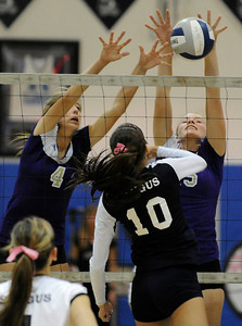 Valencia #4 Delaney Knudsen and Valencia #15 Kellie Kleszcz stop a shot by Saugus #10 Jaclyn Clark. Saugus girls' volleyball team defeated rival Valencia in 3 out of 4 games for first place in the Foothill League. Saugus, CA. 10/18/2011(John McCoy/Staff Photographer)