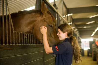 Arienne Martin of Los Angeles greets Mr. Brightside, a horse at the Mill Creek Equestrian Center in Topanga, Calif., on Friday, Aug. 19, 2011. Arienne has been riding for over three years, and comes to the ranch almost everyday for her job and to ride school-owned horses.  (Maya Sugarman/Staff Photographer)