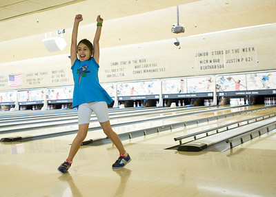 Eight-year-old Monya Wood of Winnetka celebrates after bowling a spare at Canoga Park Bowl on Friday, Aug. 19, 2011. Woods' family and friends were celebrating her brother's tenth birthday.  (Maya Sugarman/Staff Photographer)