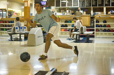 Ethan Torbati of Encino bowls with a friend on Friday, Aug. 19, 2011 at Canoga Park Bowl on Vanowen Street in Winnetka, Calif. Torbati wanted to take advantage of the Friday deal, $12 for one hour of bowling.  (Maya Sugarman/Staff Photographer)